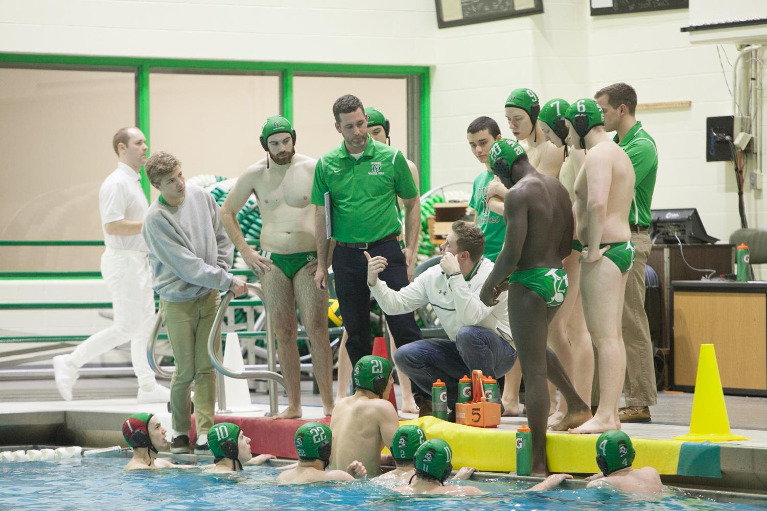 During a game in 2017 the boys varsity polo team listened as head coaches gave them advice.