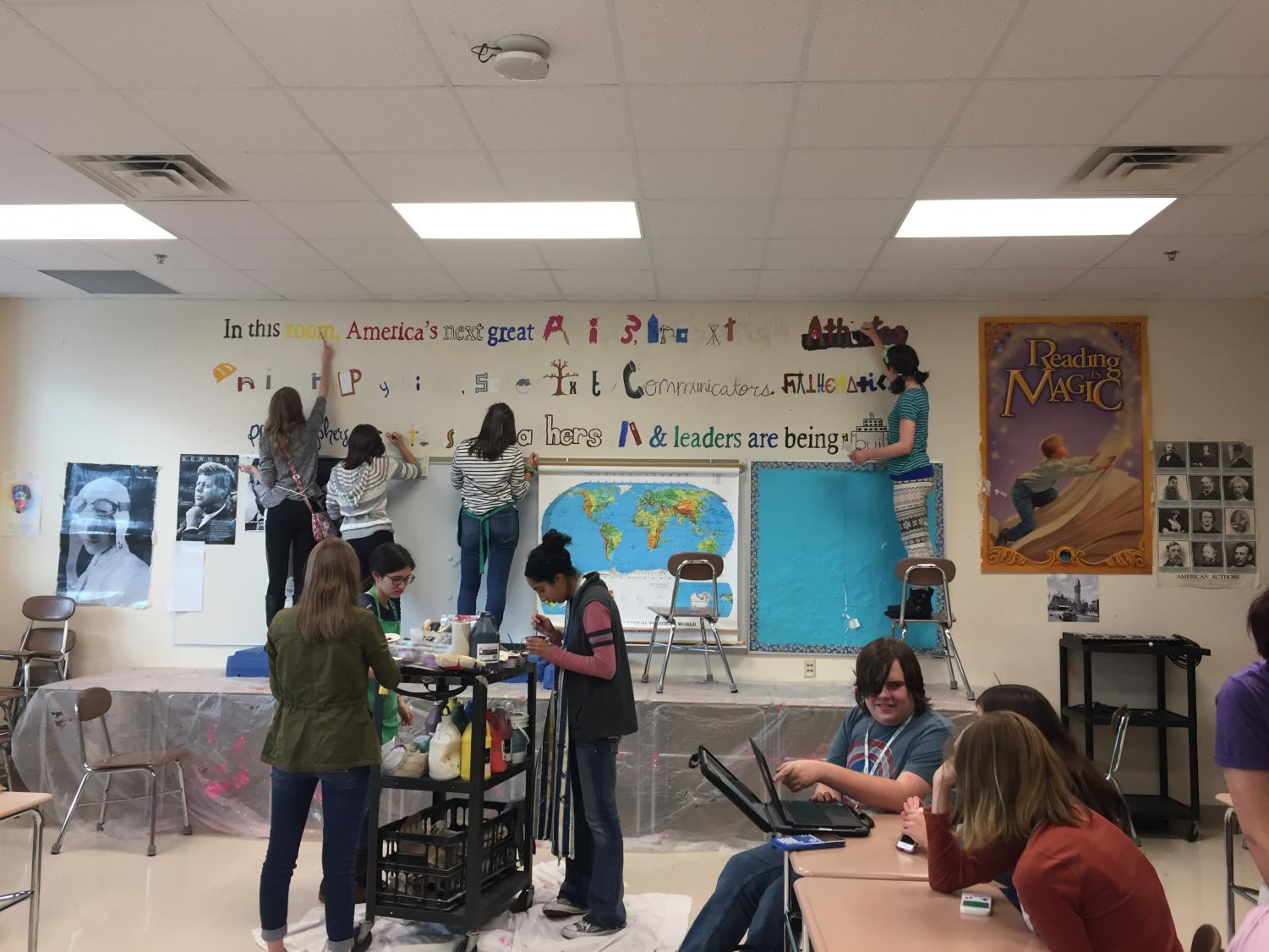 Mural Club works on the mural in Mr. Bendelow's room.