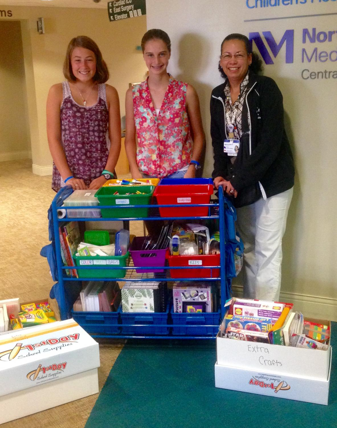 Mia Sherman and Ruby Schwan dropping off the craft cart at Dupage Hospital for the completion of their silver award.