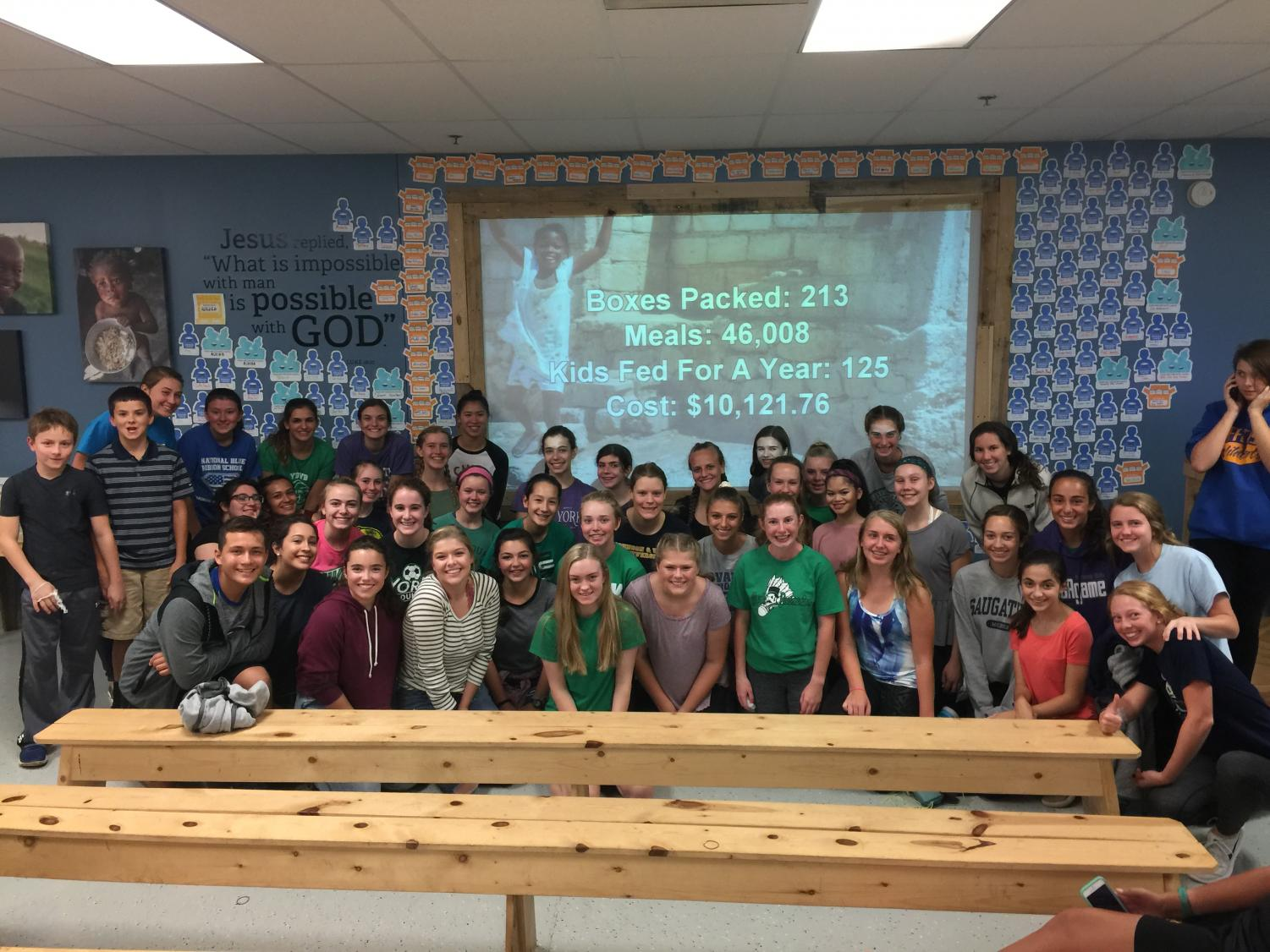 R.A.Y.S. members pose for a picture after their first field trip to Feed My Starving Children.