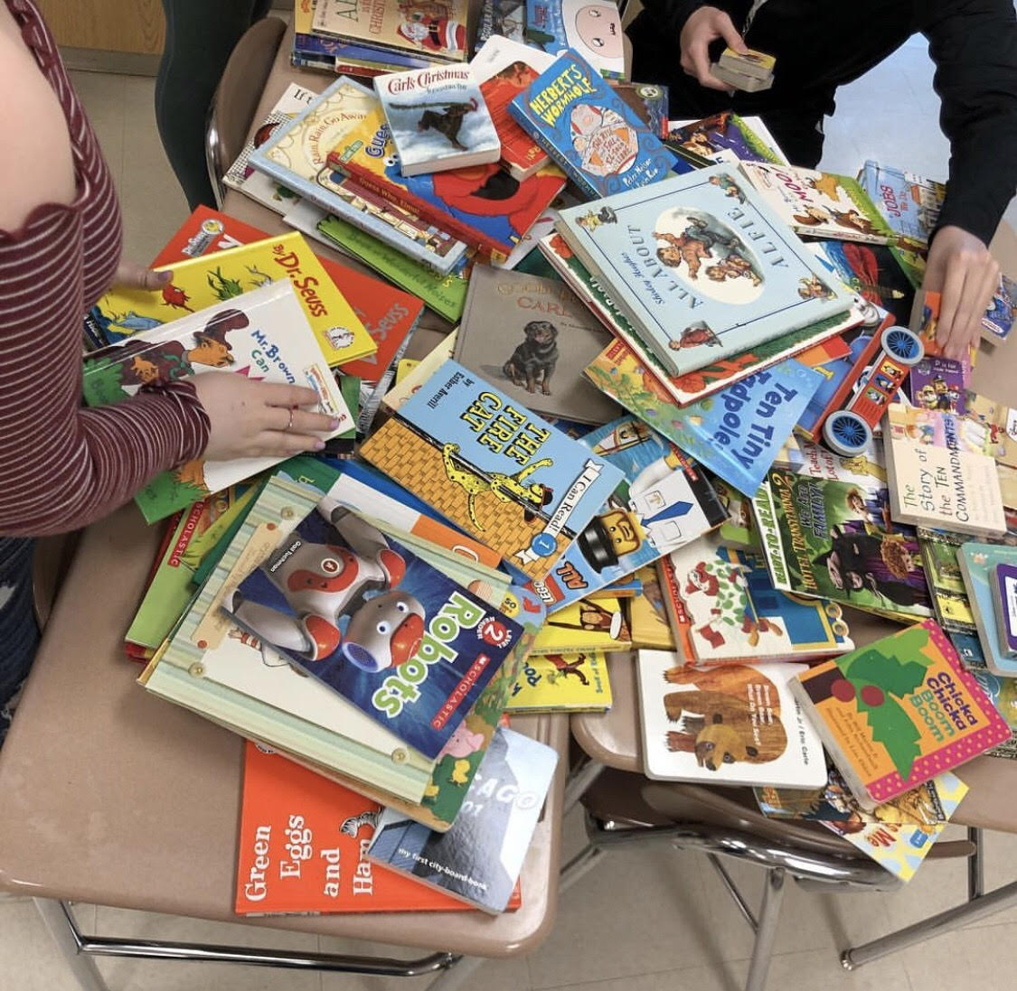 In March of 2018, Interact Club had a children's book drive; all of the donated books were given to Onward Neighborhood house.