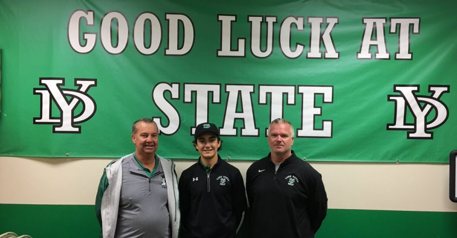 Varsity Coach Jim Borel and JV Coach Dave Kalal wish sophomore Zach Sutter good luck at the state meet.