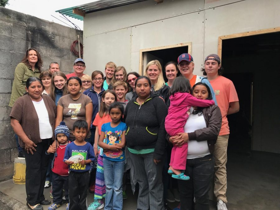 Spanish teacher, Eduvijes Martinez poses with the family in Guatemala.