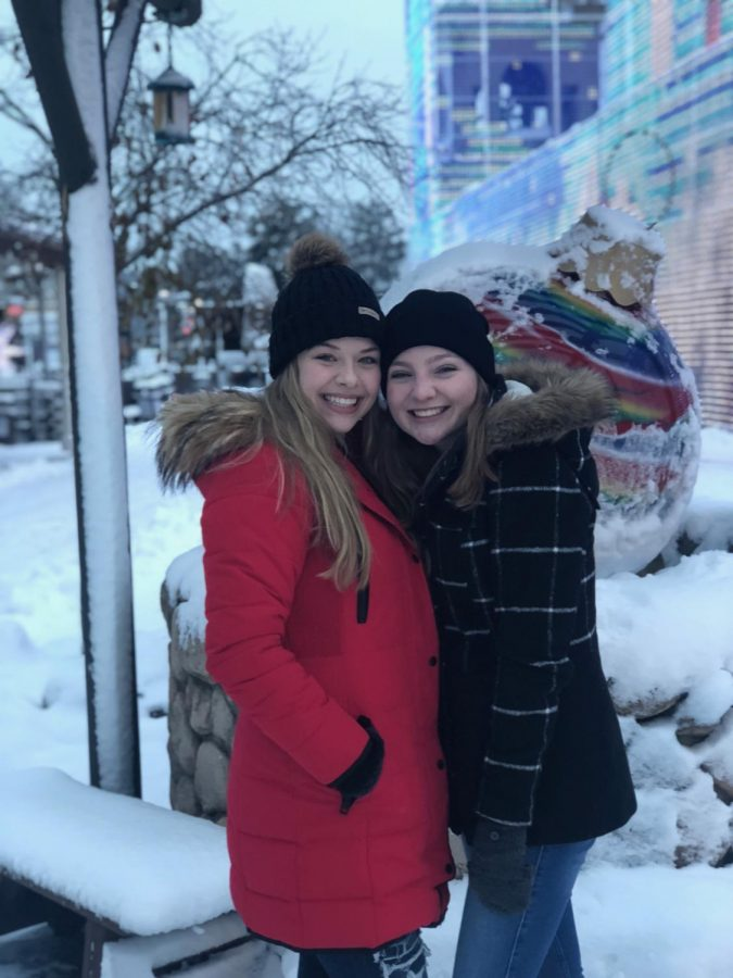 Senior Gracie Weinstein and junior Holly Kauck tour the park to tell their  audiences all about the holiday festivities in the park.