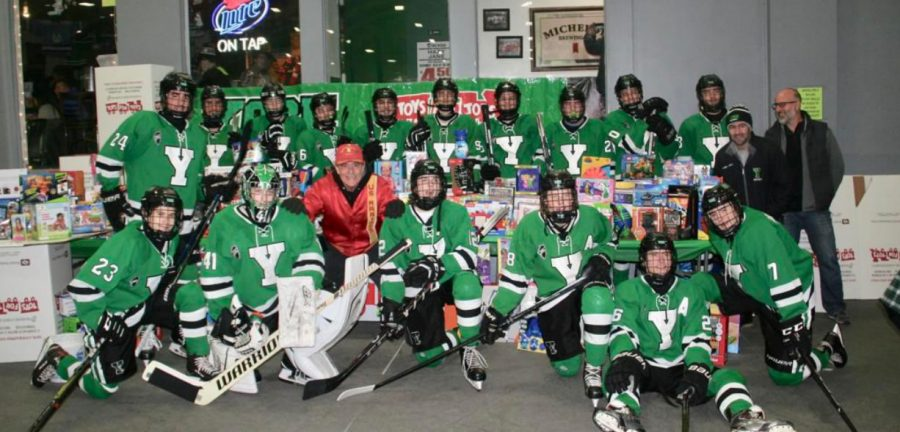 Varsity+players+celebrate+the+donations+for+Toys+for+Tots+fundraiser.+