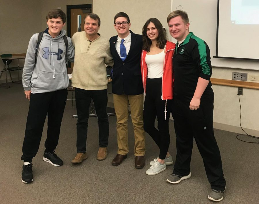 Congressman Quigley (second to the right) stands with juniors (left to right) Ryan Lynch, Ethan Thomas, Maya Wdlo, and Ronan Doyle.