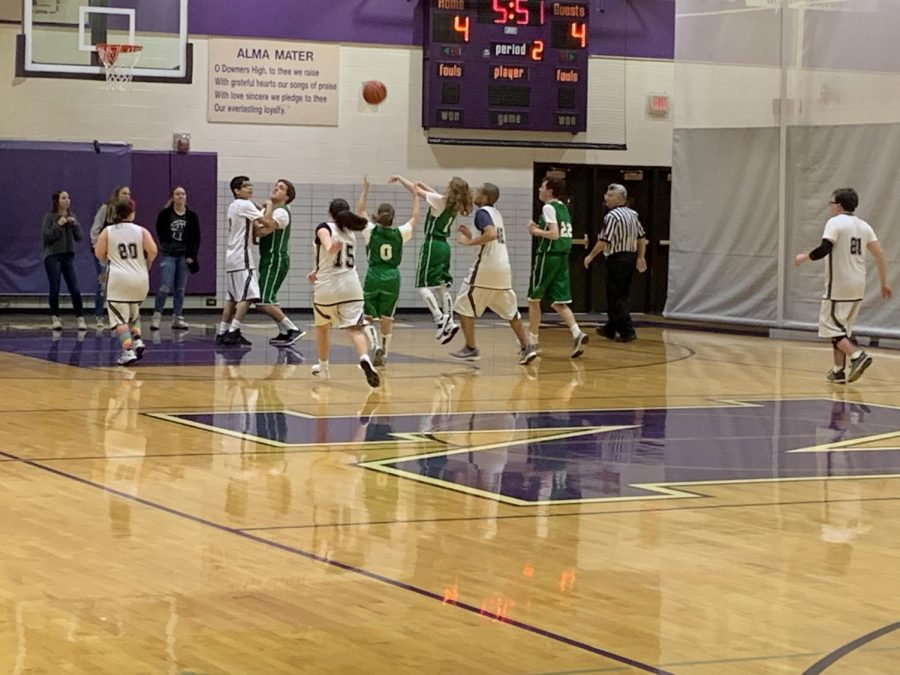Brianna Dicianni shoots a basket that breaks the tied score against Downers Grove North.