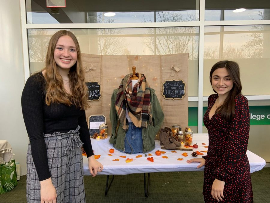 Emma+Johnson+and+Gabriella+Purpora+pose+in+front+of+their+Thanksgiving+inspired+outfit.