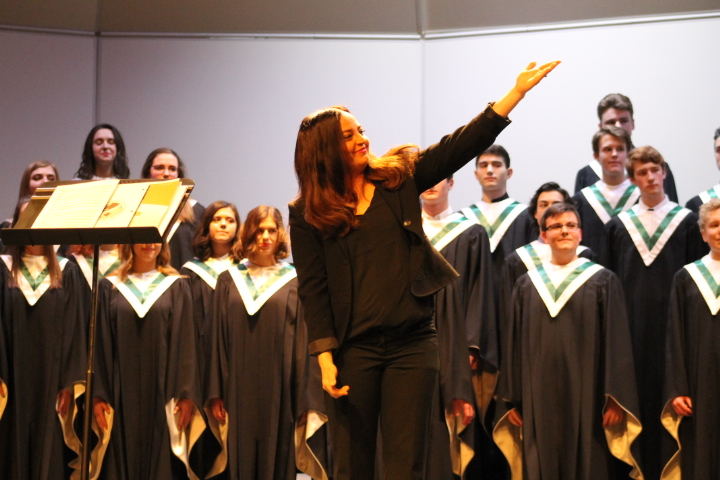 Marianetti and Concert Choir finish up another concert by acknowledging accompaniest Pamela Stefan. Stefan accompanies every non-accapella selection on piano.