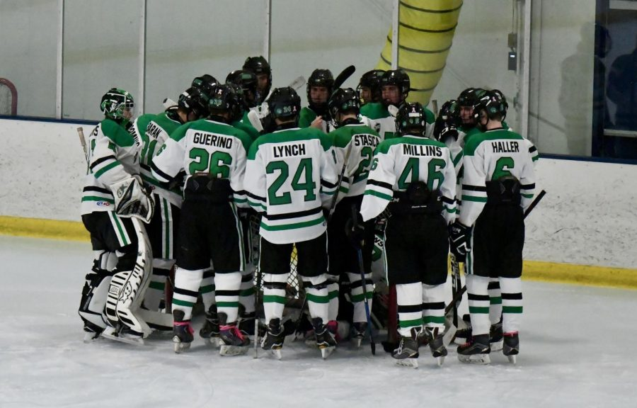 The team gets motivated in a pregame huddle before a high intensity game.