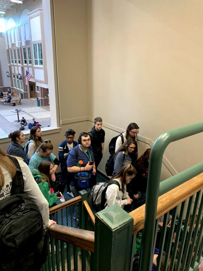 Students+wait+in+line+to+enter+the+lunchroom+due+to+new+ID+policy.+March+18%2C+2019.