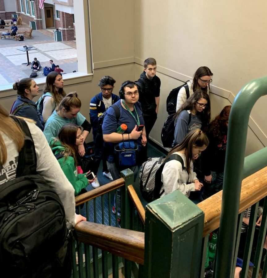 Students wait in line to enter the lunchroom due to new ID policy. March 18, 2019.
