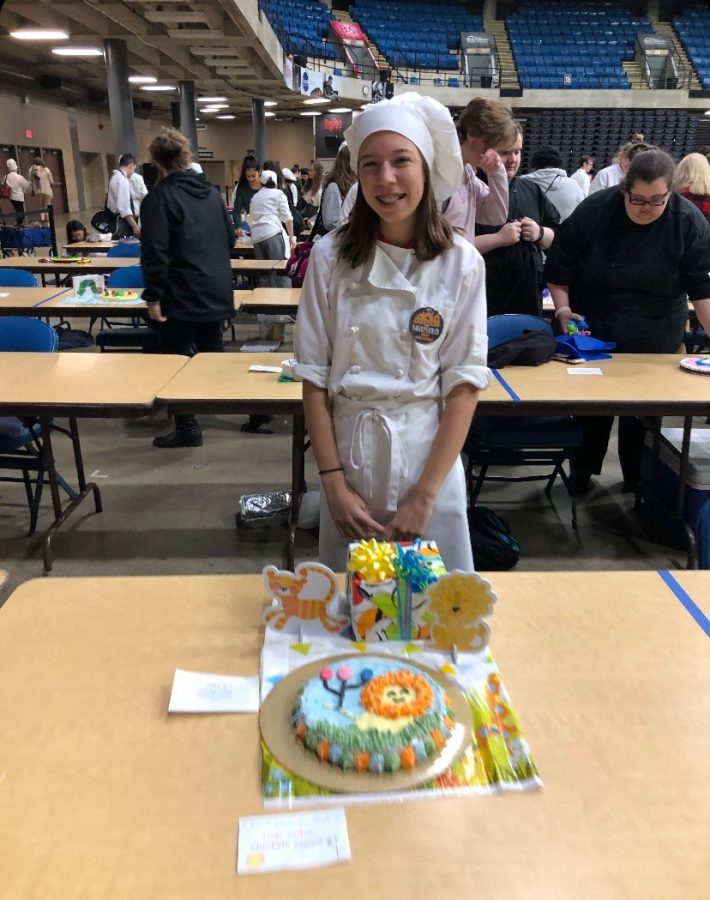 Elizabeth Greiwe won most outstanding for her cookie decorating event with her lion birthday party themed cake.
