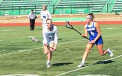 Girls Varsity Lacrosse Sticks Together