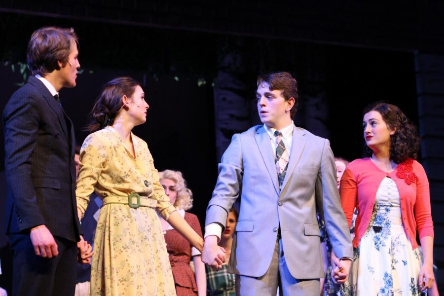 Seniors Mike Bindeman, Jimmy Ray, and Ellie Ryan, Alice, hold hands with juniors Sean Solem, Billy, and Maggie Wisnewski, Margo, in the final moments of the show.