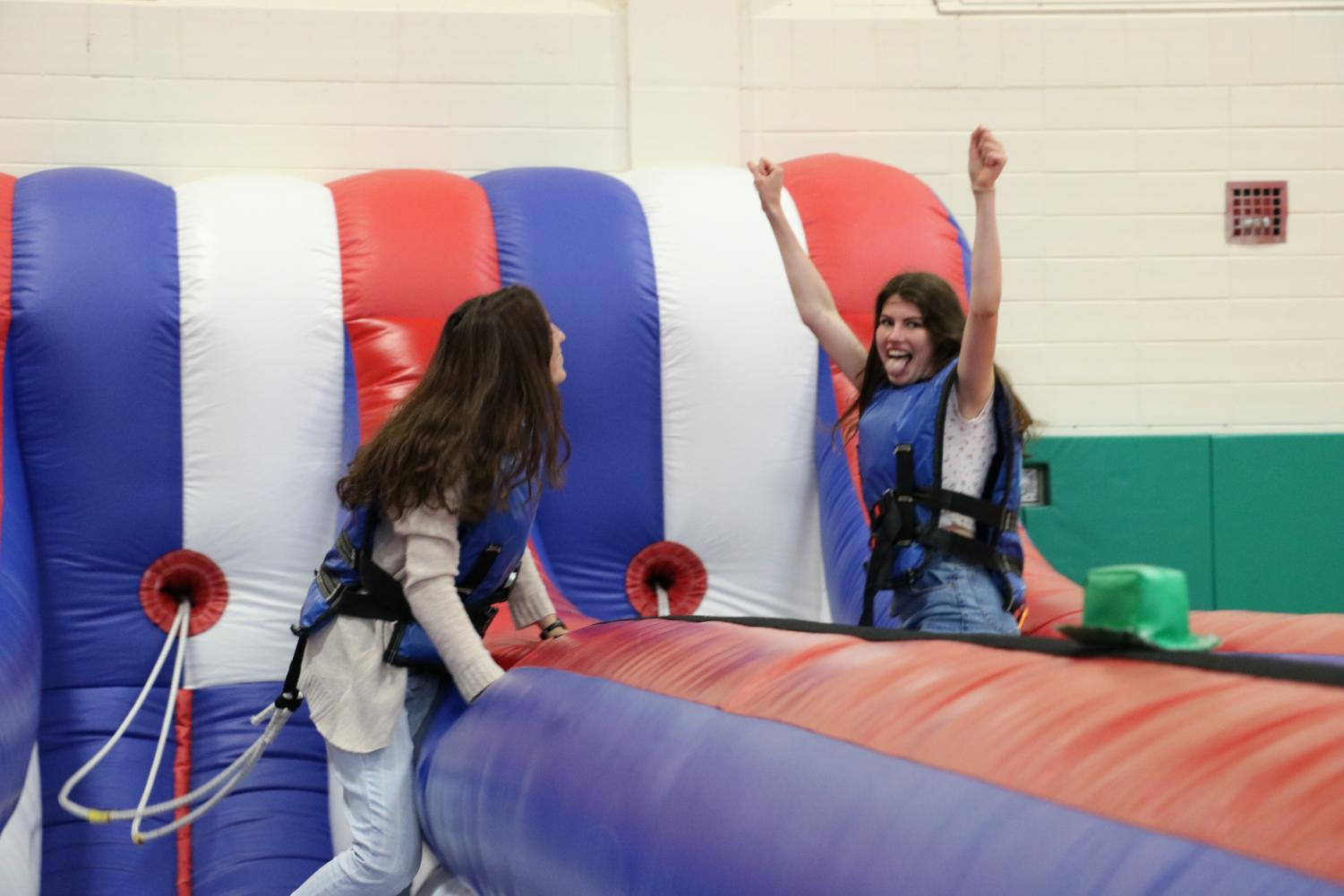 Seniors Anna Morley and Sarah Pinkowksi get pumped up to participate in the bungee run at the senior barbecue. May 17, 2019.