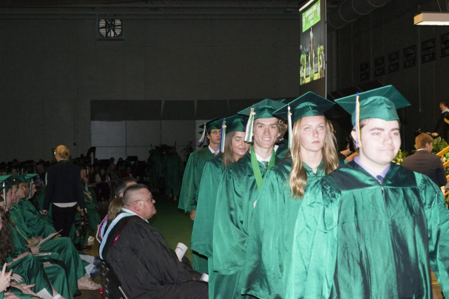 Matt+Anikiej+and+fellow+graduates+line+up+to+receive+their+diplomas.+May+19%2C+2019.%0A%0A+