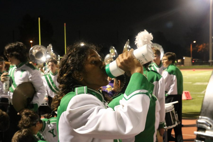 During a break between songs, junior Anjaly Kappen drinks out of one of the reusable water bottles provided for the entire marching band.