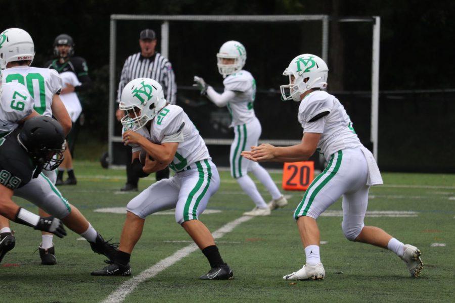 Mark+Schneider+tries+to+evade+the+Glenbard+West+defensive+line.