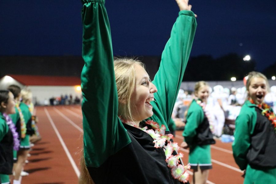 Sophomore Emma Brown directs her cheer to the field to cheer on the York football team.