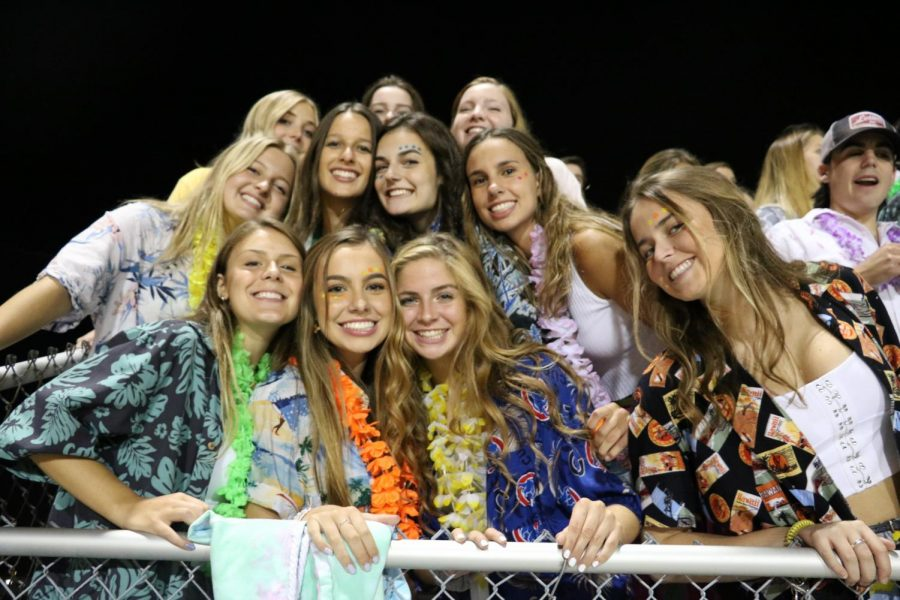 Hawaiian clad students filled the stands for the first football game of the season.