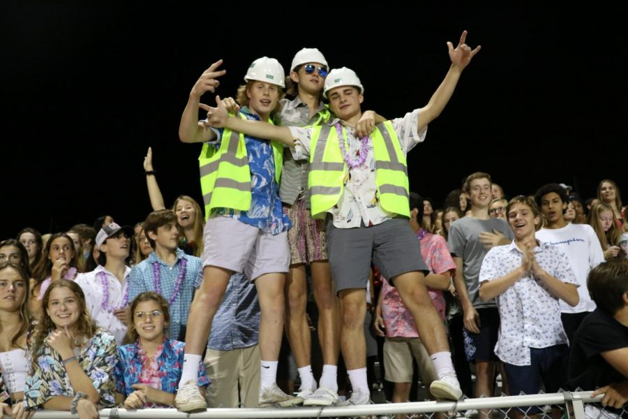 (From left to right) Jack Ray, Zach Wiygul and David Plummer support the cheer team and the football team from the stands.