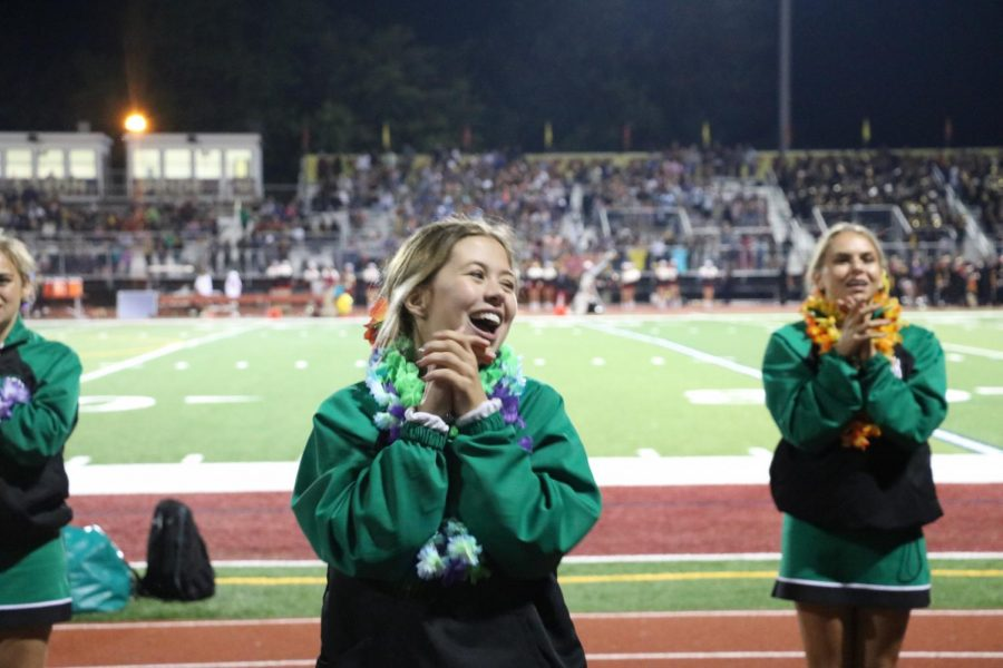 Senior Abby Coglianese motivates the crowd to cheer as the score gets closer.