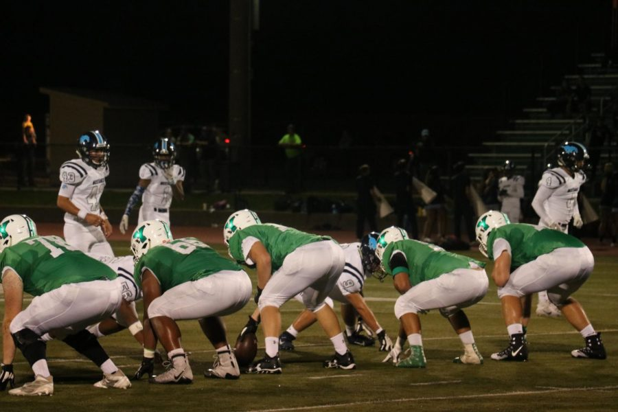 The team lines up prior to the play in the first quarter of Friday night's game.