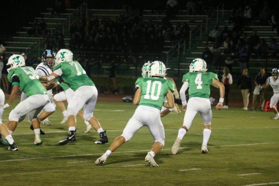 Quarterback and Junior Max Assaad looks for a reciever down the field.