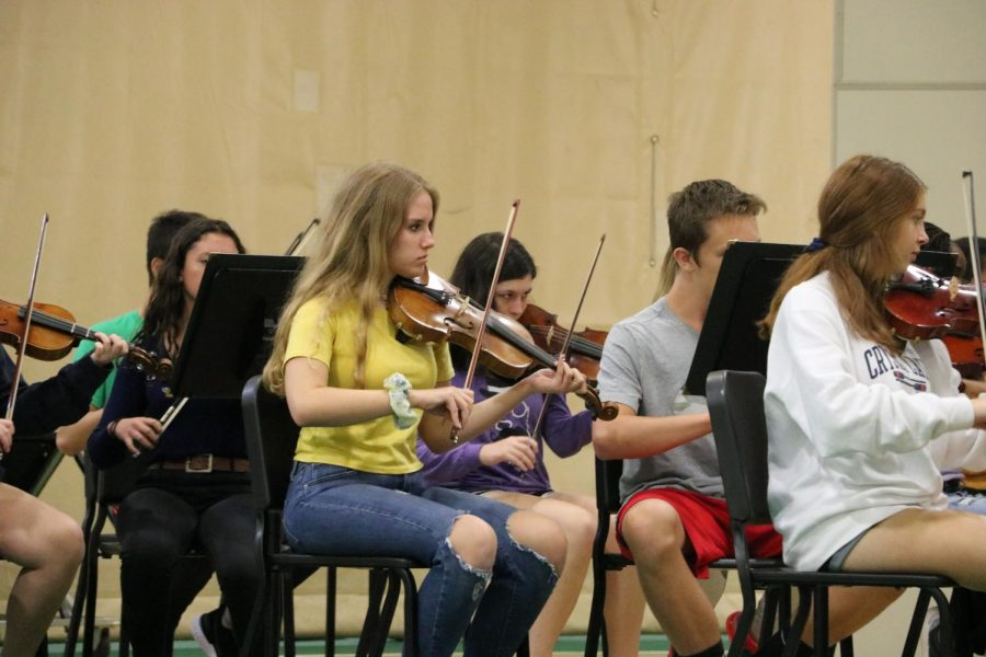 The Concert orchestra violin section performs American Reel directed by student teacher Christopher Monzel.