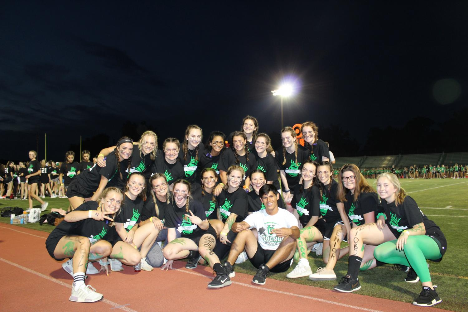 Quarter two seniors pose for a picture at the annual powder puff game.