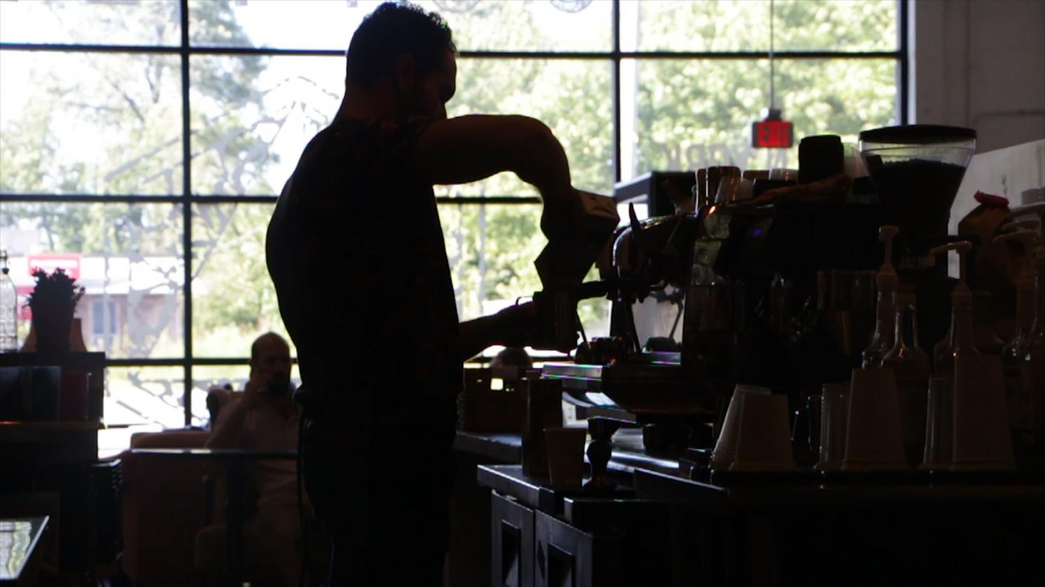 Shift manager Alex Orsi brews a coffee at the Workshop and Roastery location in north Elmhurst.
