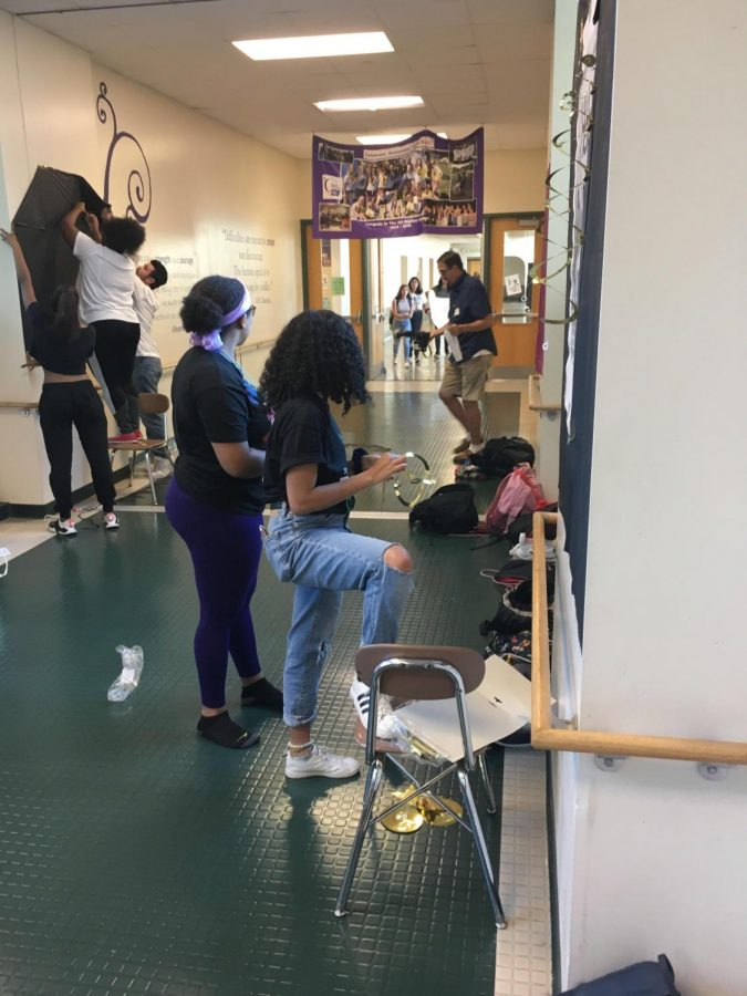 Black Student Union Secretary and senior Gigi Stechulte and junior Dasha Brooks work on decorating their homecoming hallway in the short amount of time given. Photo Courtesy of Zikora Nnam