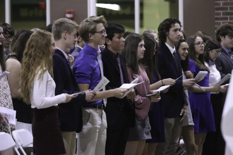 NHS members of the class of 2020 participate in the closing statement of the NHS Induction Ceremony.