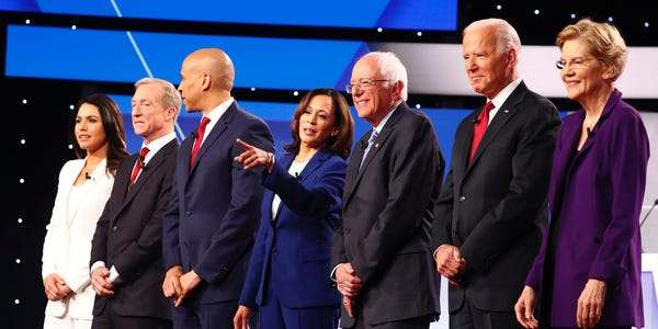 Candidates pose for a group photo before the beginning of the fourth Democratic Debate.