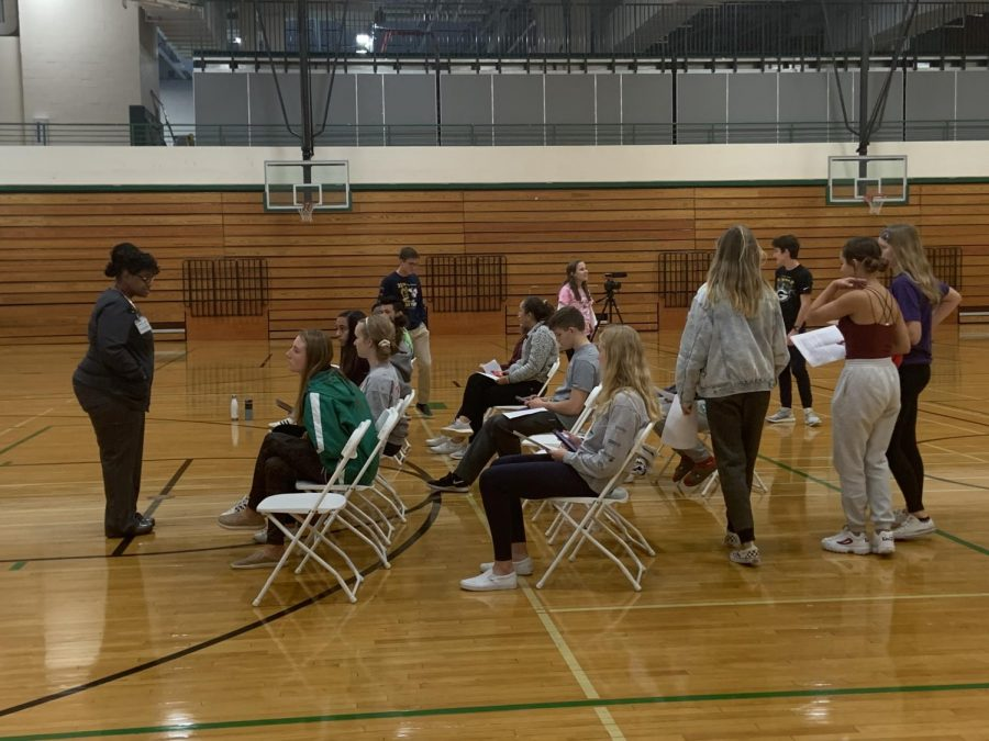 The nurses inform the students of certain requirements prior to them donating blood.