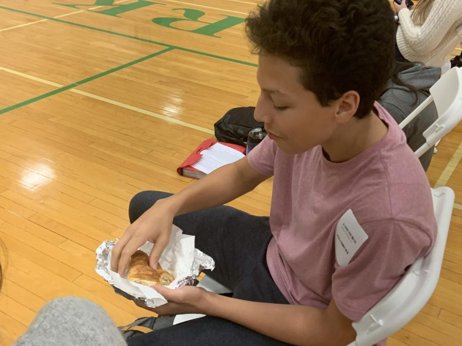 Senior Jorge Shaw ate a sandwich to ensure he was able to donate.