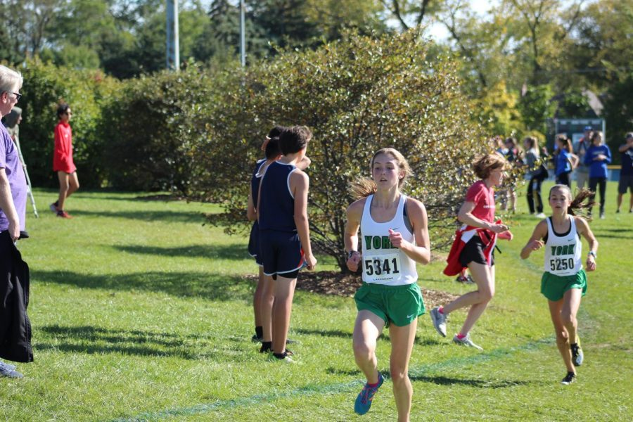 Sophomore Katelyn Winton races past the crowd with freshmen Bria Bennis close behind. Oct. 19, 2019.