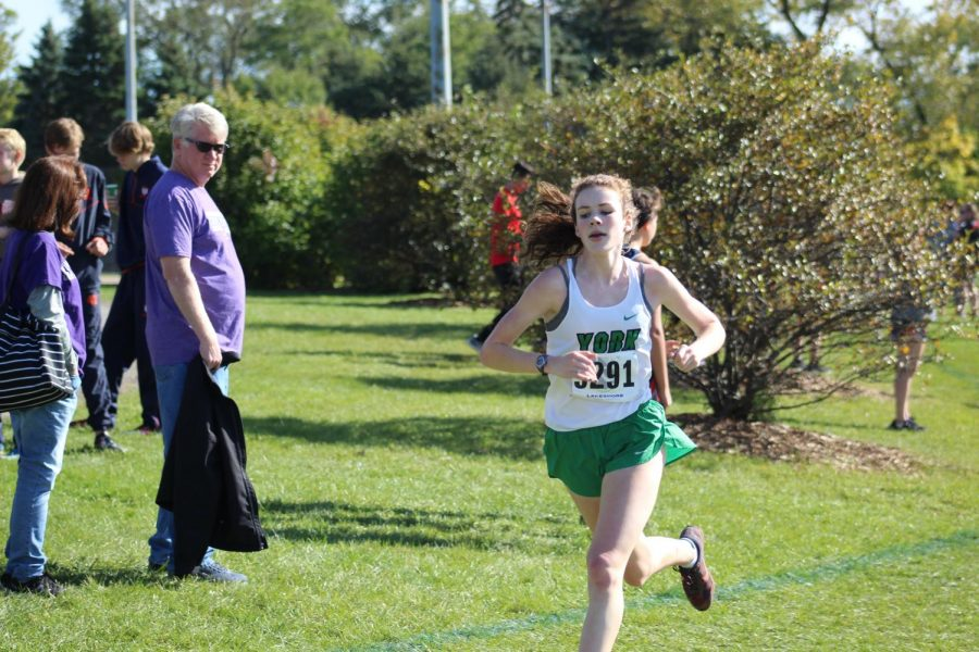 Senior Lydia Hickey begins her sprint as she nears the end of the three-mile race. Oct. 19, 2019.