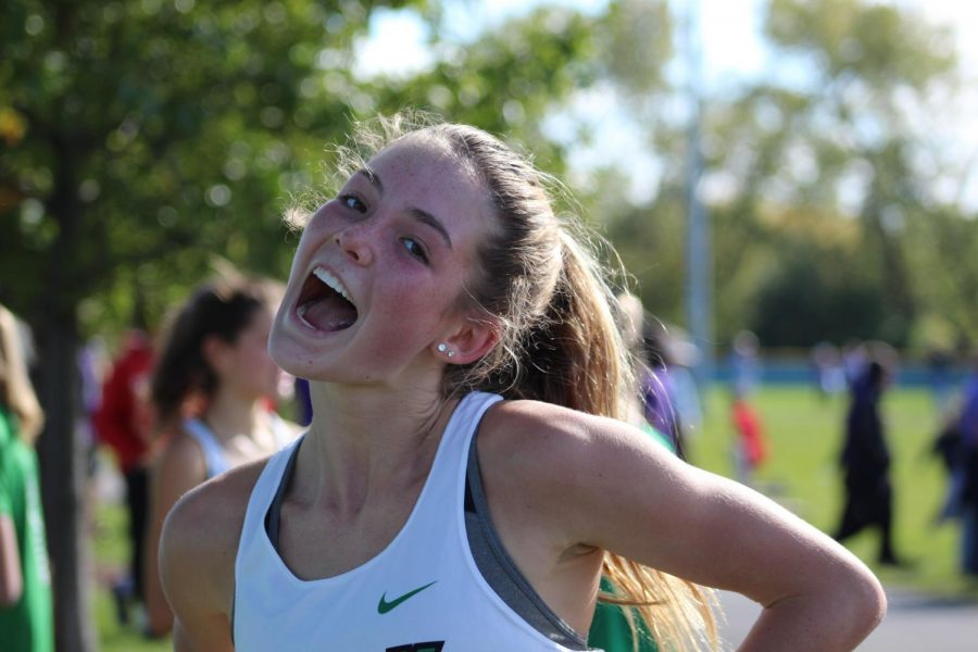 Sophomore Katelyn Winton is ecstatic after finishing her conference meet race as the second runner for the Dukes. Oct. 19, 2019.