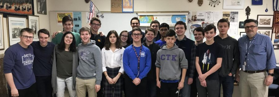 Former members of the Model United Nations club pose for a photo during a meeting in January.