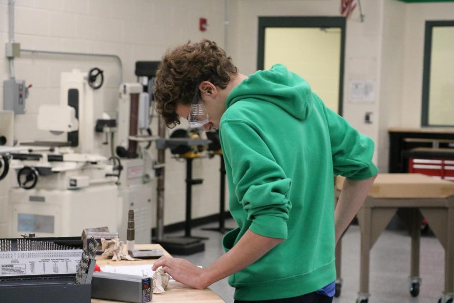 Student reviews blueprints for project in Manufacturing class.