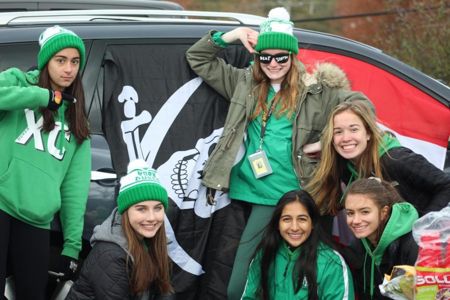Seniors Mary Kritikos, Rachel Perry, Abby Moriarty, Ayesha Siddiqi, Ally Splitstone and Courtney Dunlap show their school spirit at the tailgate.
