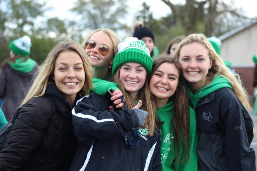Seniors Ariel Kimbler, Emma Fahey, Kelsey Devereaux, Mary Clare Hughes and Leah Pozen cheer on the York Dukes at the Lake Park Sectional.