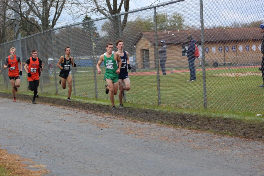 Junior Colin Hill nears the home-stretch of the meet as he nears the entrance to the track. Saturday, November 2, 2019.