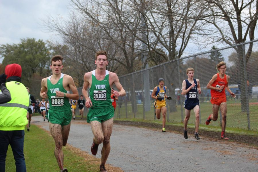 Seniors Will Yasdick and Michael Moriarty persevere through the muddy course at the Lake park Sectional meet. Saturday, November 2, 2019.