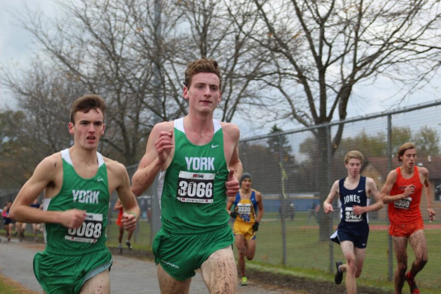 Seniors Will Yasdick and Michael Moriarty stick together as they reach the halfway point of their race. Saturday, November 2, 2019.