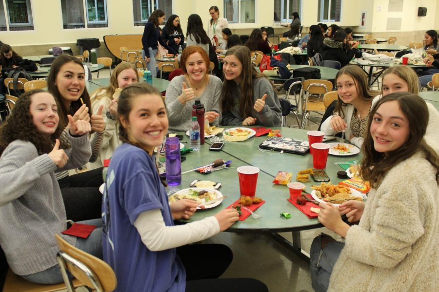 Members of Italian, Spanish, and French Club merge together to enjoy International Potluck.
