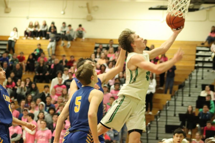Senior, Nate Shockey soars through the air for an easy lay in.