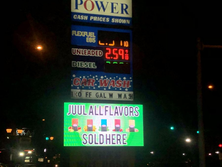 Power+Mart%2C+a+local+gas+station+showcases+an+ad+for+Juul+Flavors.+